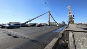 Krymsky Bridge or Crimean Bridge winter day is a steel suspension bridge in Moscow, Russia. The bridge spans the Moskva River 1800 metres south-west from the stock video