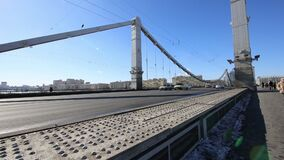 Krymsky Bridge or Crimean Bridge winter day is a steel suspension bridge in Moscow, Russia. The bridge spans the Moskva River 1800 metres south-west from the stock footage