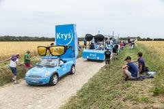 Krys Caravan auf einem Kopfstein-Straßen-Tour de France 2015 Lizenzfreie Stockbilder