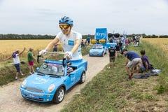 Krys Caravan on a Cobblestone Road- Tour de France 2015 Royalty Free Stock Photos