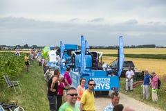 Krys Caravan on a Cobblestone Road- Tour de France 2015. Quievy,France - July 07, 2015:Krys Caravan during the passing of the Publicity Caravan on a cobblestoned royalty free stock images