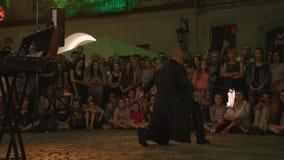 Krystian Minda Sword Swallower Show in Lublin Stock Afbeelding
