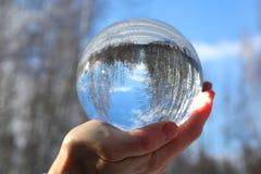 Kryształowa kula w ręce Obrazy Royalty Free