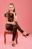 krzesła dziewczyny obsiadanie Fotografia Stock