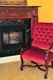 krzesła kominka czerwień Obrazy Royalty Free
