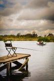 Krzesło na doku z połowu prąciem Fotografia Royalty Free