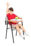 krzesło ręka sadzający dźwiganie jego uczeń Zdjęcia Royalty Free