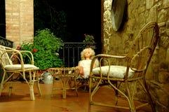 Krzesła i lala na balkonie 3 Zdjęcia Royalty Free