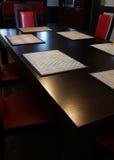 krzeseł czerwieni stół Obrazy Stock