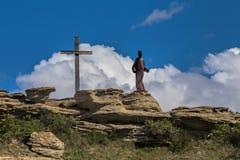 Krzyż i statua obraz royalty free