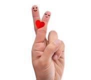 Krzyżujący palce robi romantycznej pozie Zdjęcie Stock