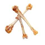 Krzyżuję podnosił kurczak kości odizolowywać na białym tle Obrazy Royalty Free