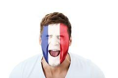 Krzyczący mężczyzna z Francja flaga na twarzy Zdjęcie Royalty Free