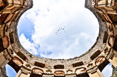 Krzyztopor - impressive castle ruins and flock of birds, Poland Stock Photo