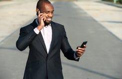 happy smiling urban professional man using smart phone02 Stock Images