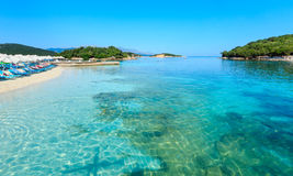 Ksamil beach, Albania. Beautiful Ionian Sea with clear turquoise water and morning summer coast view from beach Ksamil, Albania. People unrecognizable stock photo