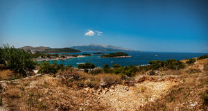 Ksamil a village and a former municipality in the riviera of Southern Albania, and part of Butrint National Park. August 2016. View from top of the moutain Stock Image