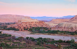 Ksar of Ait-Ben-Haddou and surroundings at dawn, Morocco.    Ait-Ben-Haddou along the bank of a parched river Royalty Free Stock Photos