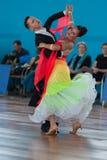 Ksenzhik Pavel и Stanislavchik Mariya выполняют программу стандарта Youth-2 Стоковые Фотографии RF