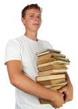 książek samiec proudlyholding sterty ucznia potomstwa Zdjęcie Royalty Free