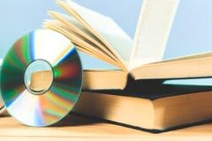 Książka i DVD dysk Obraz Royalty Free