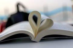 Książka i serce Śpiewamy Zdjęcie Stock