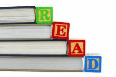Książki i CZYTAJĄCY bloki Obrazy Stock