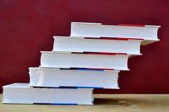 Książki i waza Obrazy Royalty Free