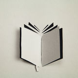 Książkowa ikona ciąca out od papieru Zdjęcia Royalty Free