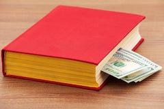 książkowi biznesowi dolary pieniądze szkolenia Fotografia Stock