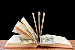 książkowi biznesowi dolary pieniądze szkolenia Fotografia Royalty Free