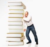książkowy mężczyzna stosu pchnięcie Zdjęcia Royalty Free