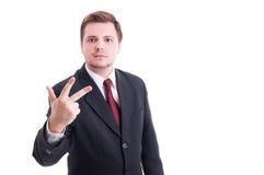 Księgowego lub biznesmena seans liczba trzy z palcami fotografia stock