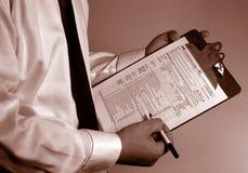 księgowy konsultanta papierkowej roboty podatku Fotografia Stock