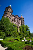 Ksiaz Castle, Walbrzych, Poland. Tourists in gardens outside Ksiaz Castle in Walbrzych, Poland against blue skies on sunny day Stock Photography