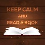 Książkowy plakat Utrzymanie spokój i Czytający książkę Otwiera książkę z tajemniczym jaskrawym światłem na drewnianym tle również Zdjęcie Stock