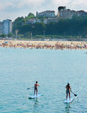 KSUP, Paddle surf in the beach. Royalty Free Stock Photography