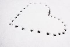 Kształt serce na śniegu Fotografia Royalty Free