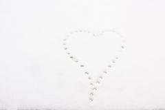 Kształt serce na śniegu Zdjęcia Stock