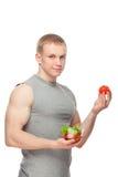 Kształtny i zdrowy ciało mężczyzna trzyma świeżej sałatki Obrazy Royalty Free