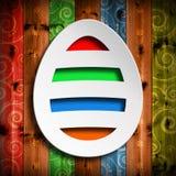 Kształt Wielkanocny jajko na drewnianym tle Obrazy Royalty Free