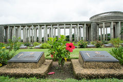 KTAUK KYANT, MYANMAR - JULY 29: War graves at the Htauk Kyant war cemetery on JULY 29, 2015 in Ktauk Kyant, Myanmar. The cemetery Royalty Free Stock Photo