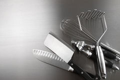 Ktchen utensils on stainless steel royalty free stock image