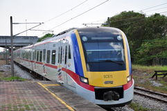 KTM Komuter Train. A KTM Komuter Train arriving at Shah Alam Station in Malaysia Royalty Free Stock Image