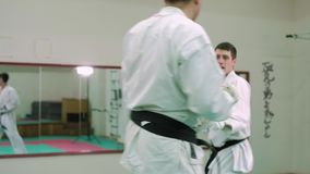 KTwo karate players compete in the ring 4k stock video footage