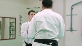 KTwo karate players compete in the ring 4k stock video