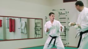 KTwo karate players compete in the ring 4k stock footage