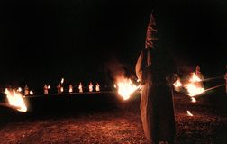 Panhandle, Florida, United States - circa 1995 - Ku Klux Klan KKK Night Ceremony Members in White Robes, Hoods and burning torches. Ku Klux Klan Night Rally Stock Photography