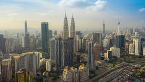 Kuala Lumpur city center view during dawn overlooking the city skyline in Federal Territory, Malaysia.