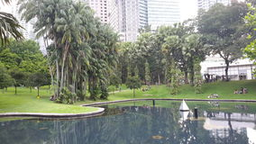 Kuala Lumpur. City Park with a view to new architecture of this city Royalty Free Stock Photos